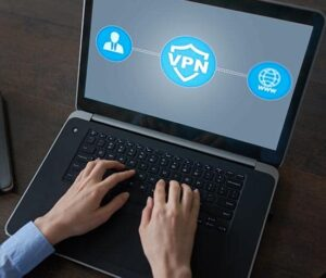 a laptop running a vpn program being used by a man