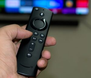 an amazon firestick tv remote being used