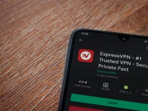 An image featuring a phone that has opened the application ExpressVPN to download