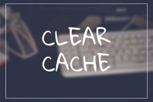 An image featuring the text clear cache with a keyboard in the background representing clearing cache