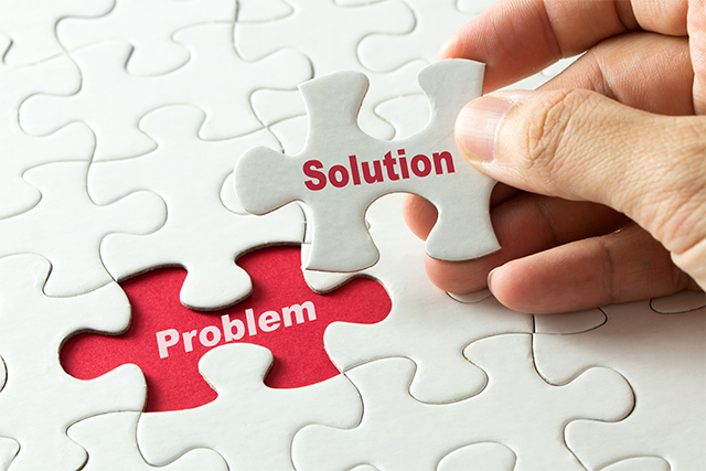 An image featuring a person finishing his puzzle that says solution on it