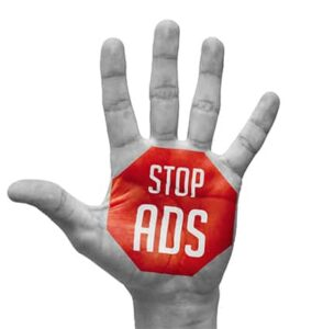 An image featuring a person holding out his hand wide opened that says stop ads on it with a red background representing an ad blocker concept