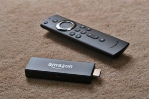 An image featuring an Amazon Fire TV stick remote