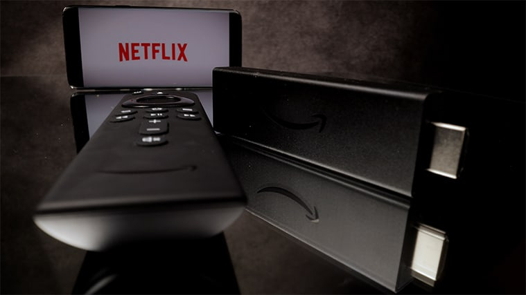 An image featuring the Fire TV Stick 4k with Netflix opened in the background