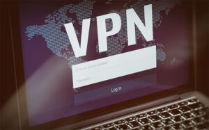 An image featuring a laptop that has a VPN application with an account form representing VPN concept