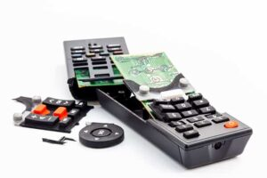 An image featuring a damaged TV remote concept