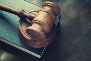 An image featuring a gavel representing legality concept